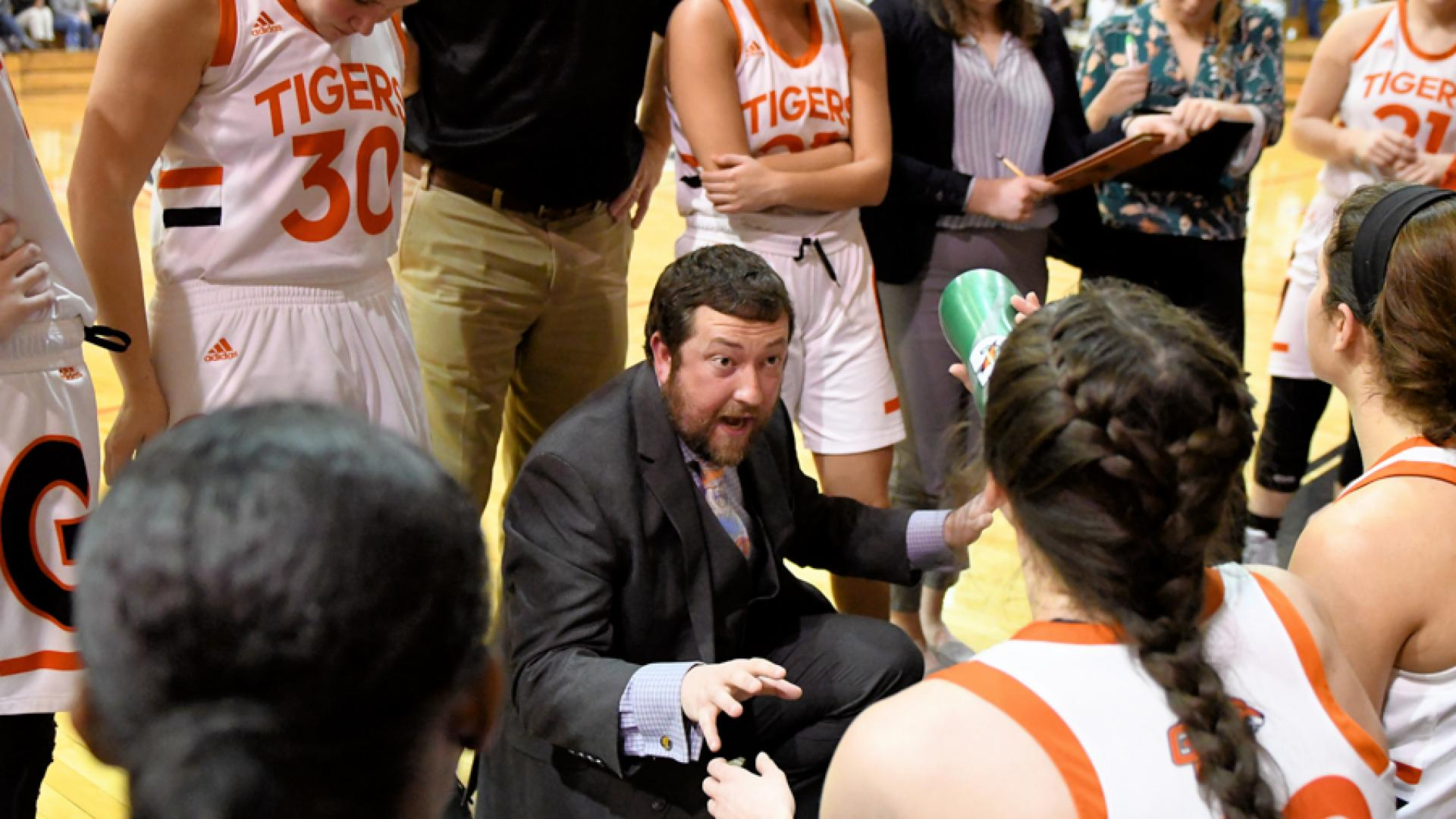 Coach James Jackson speaks to team during a timeout