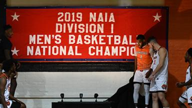 Players next to championship banner