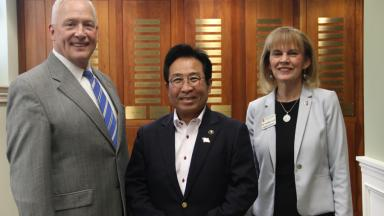 Mayor Tom Prather, Mayor Masayoshi Yamashita, and Dr. Rosemary Allen