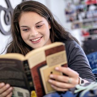 reading in dorm bed